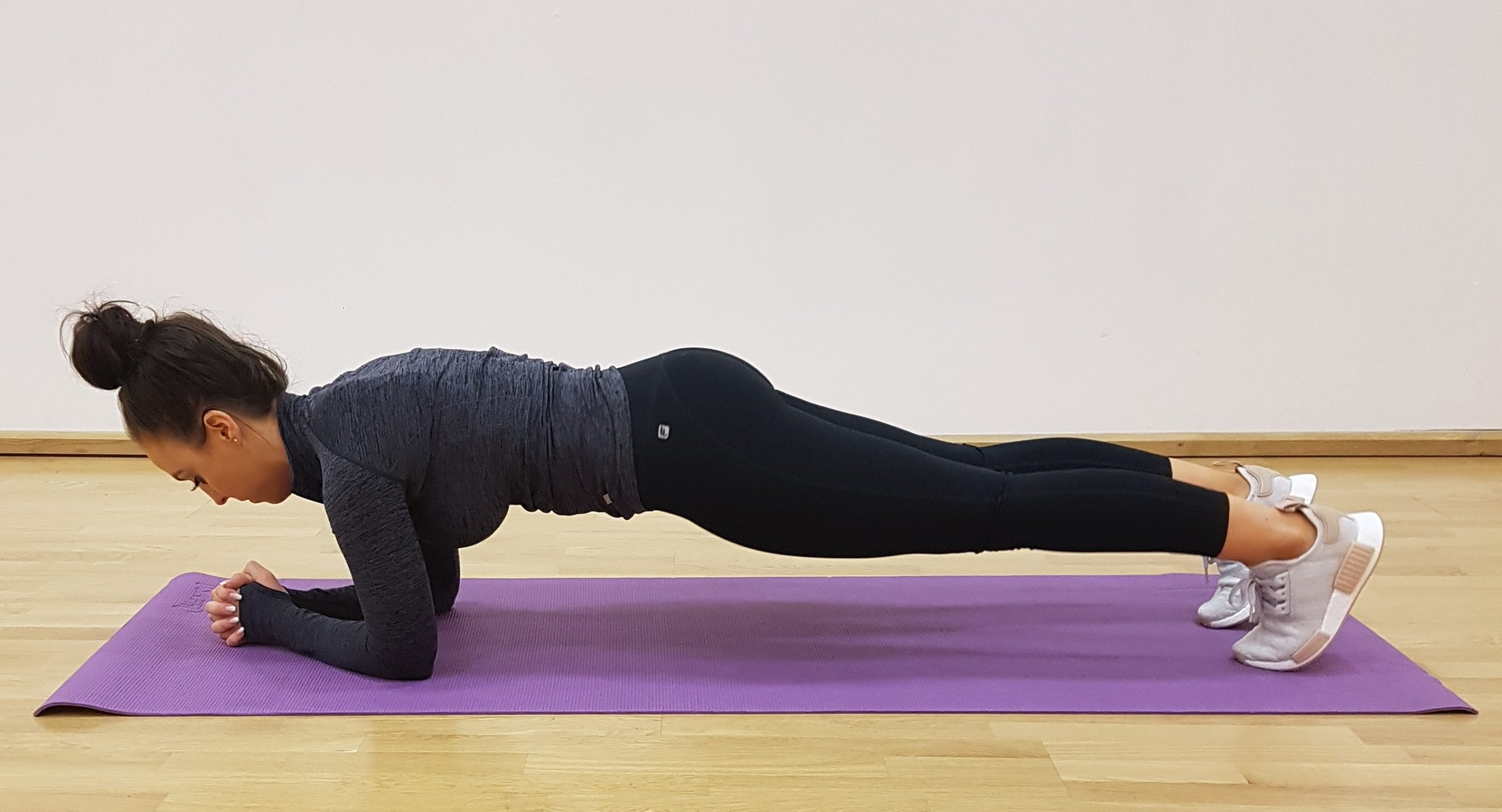 woman in basic plank position